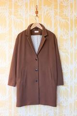 Manteau Fuji, manches longues. Deux poches sur les côtés. Se