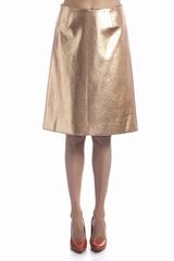 La jupe évasée Cédric Charlier et une jupe genoux cuivrée