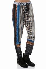 Pantalon multi imprimes. Taille elastique avec un lien. 100%