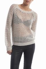 Le pull Ferne Iro est un pull ample à col rond et à manches