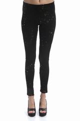 Pantalon elastique. 40% nylon, 55% polyester.