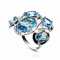 Bague composée de 5 pierres type topaze bleu ciel, ovales à