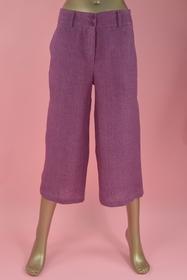 Pantalon en lin. boutons et zip. poches. longueur : 81 cm.