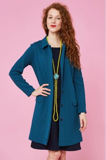 Nice straight long coat with fantasy pattern. Classic collar