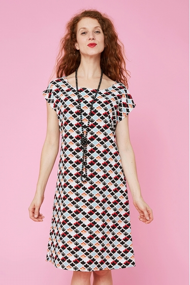 Fluid dress delicately textured with cute clouds patterns.
