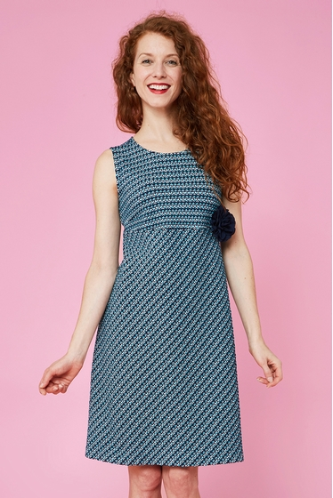 Nice dress lightly flared with fantasy patterns. Boat-neck