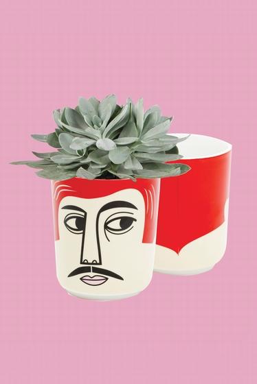 Pot en céramique avec visage. 10 x 12 cm.