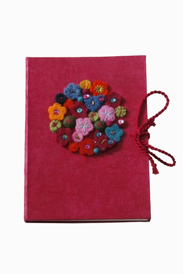 Book full of flowers, unpredictable colour. Size 15X21cm.