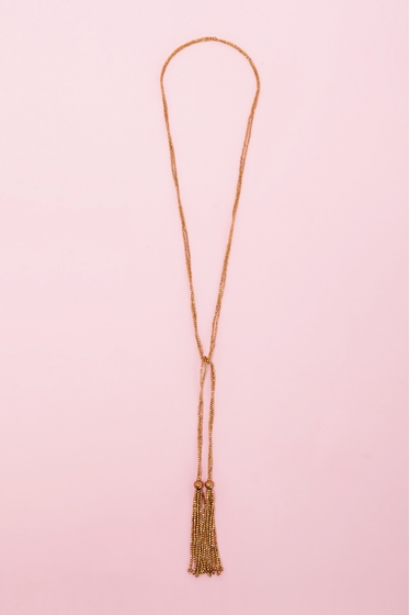 Long necklace with pompoms. <br> <br> Wears multiple ways to