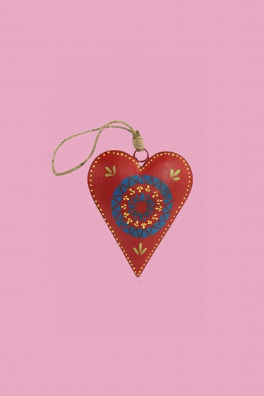 Nice patterned heart delicately painted . You can hang it on
