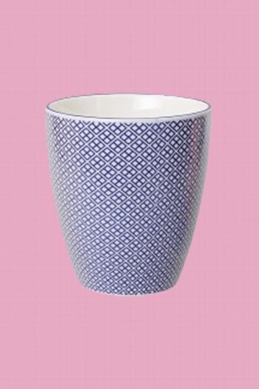 Tasse en porcelaine. Fabriqué au Japon.