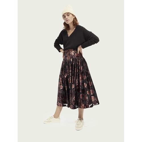 Vous tomberez sous le charme de cette magnifique jupe