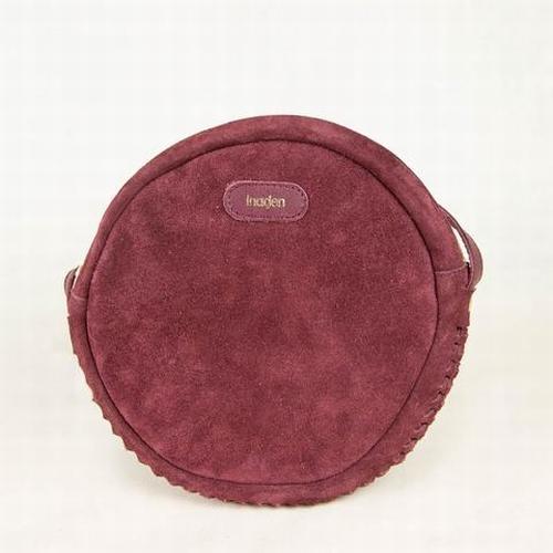 Découvrez ce magnifique petit sac rond en cuir suédé Gabi de
