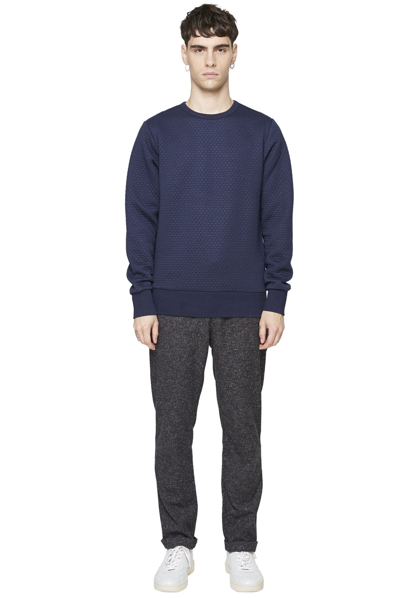- Polyester sweater - Round collar - Finish of wrists and
