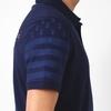 Polo manches courtes en jersey coton. Bord côte au col et en