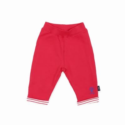 Pantalon en jersey coton élasthanne. Taille élastiquée.