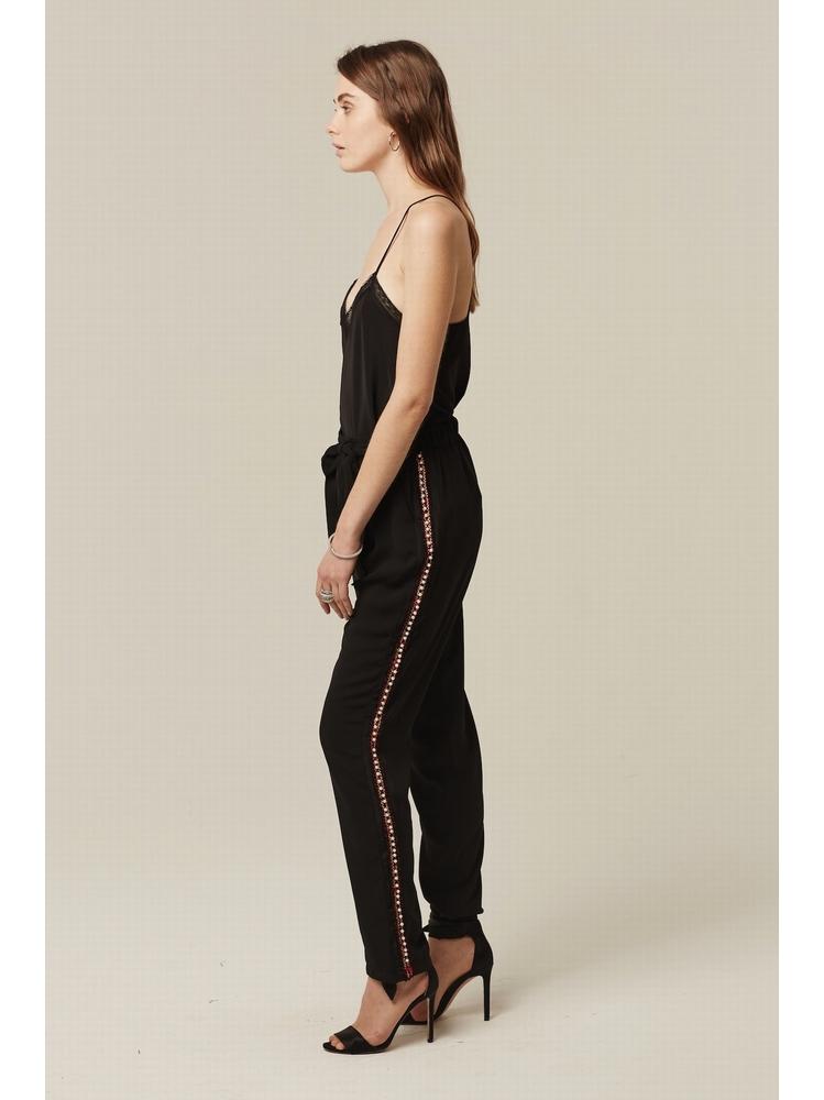 - Pantalon à pinces noir avec bandes latérales rouges