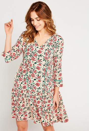 Notre robe midi Mia se pare d'un imprimé fleuri subtil et